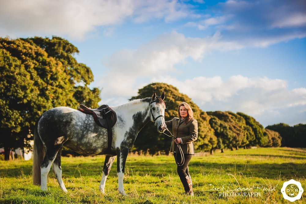 a rider and her horse in a field in cheshire