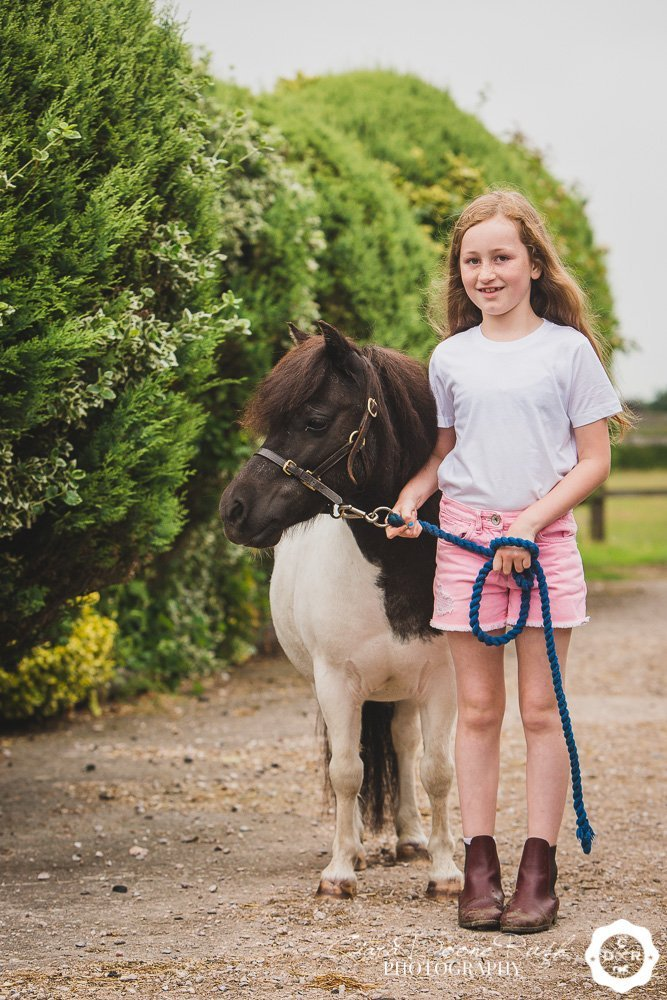 a girl and her shetland pony