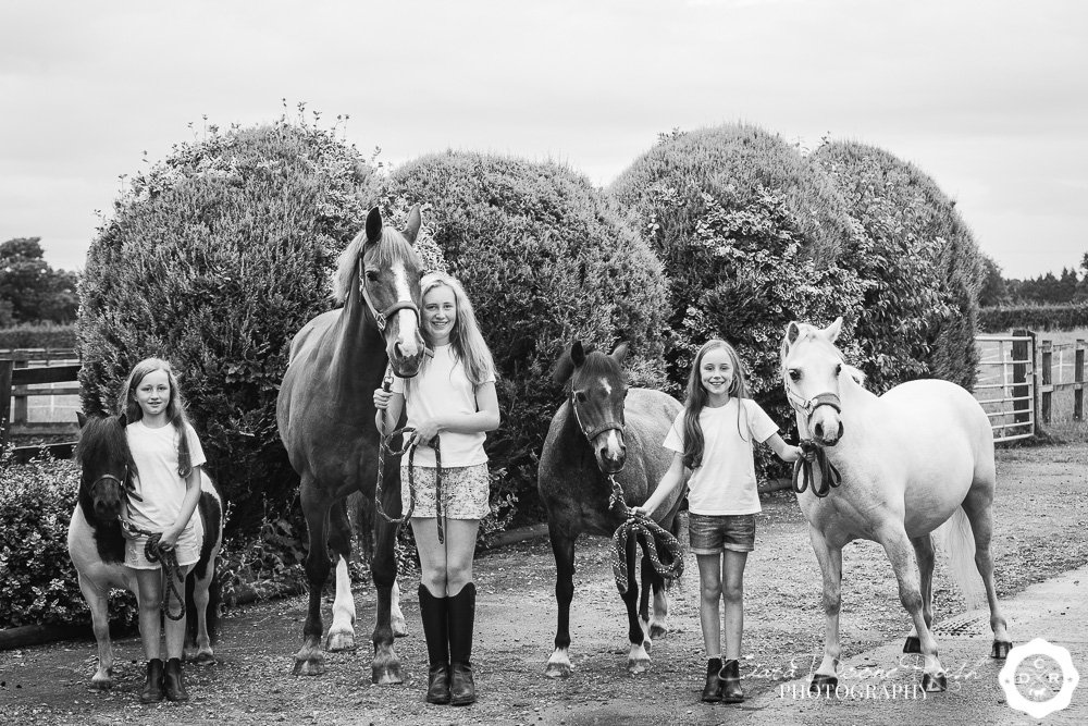 Three kids and their four ponies on a kids and ponies photo shoot