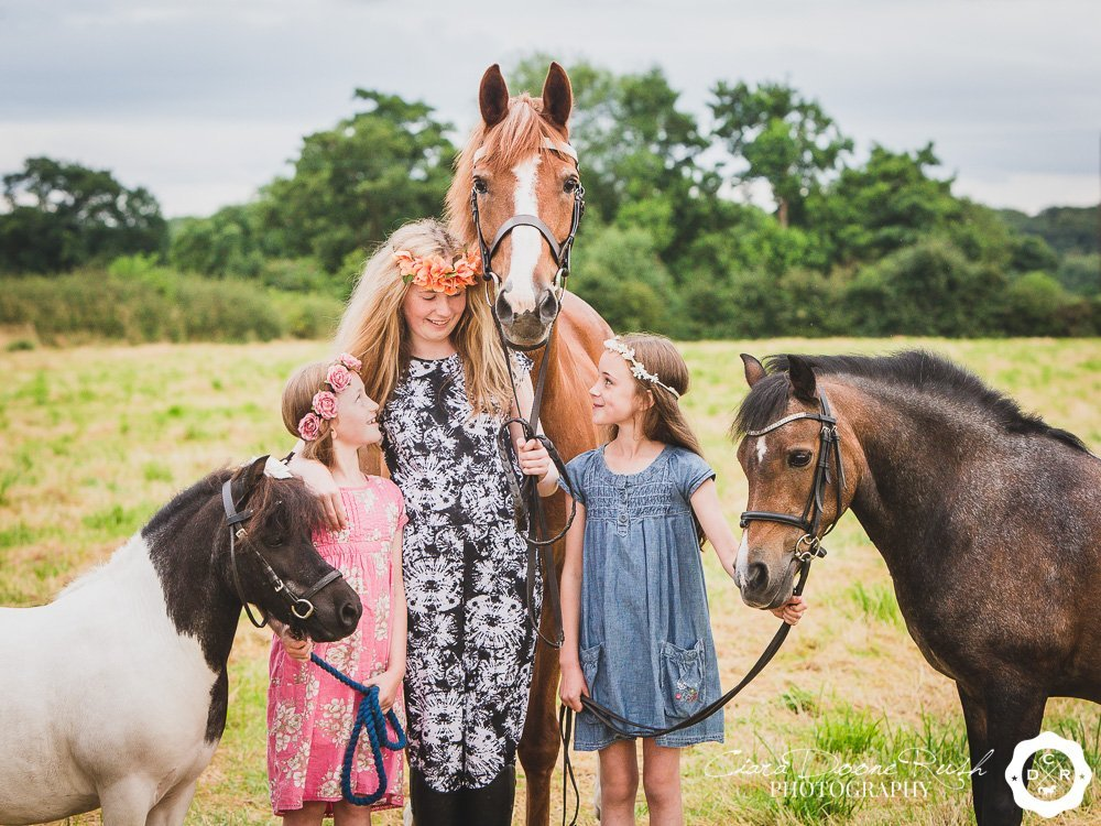 Three sisters and their ponies on a kids & ponies photo shoot