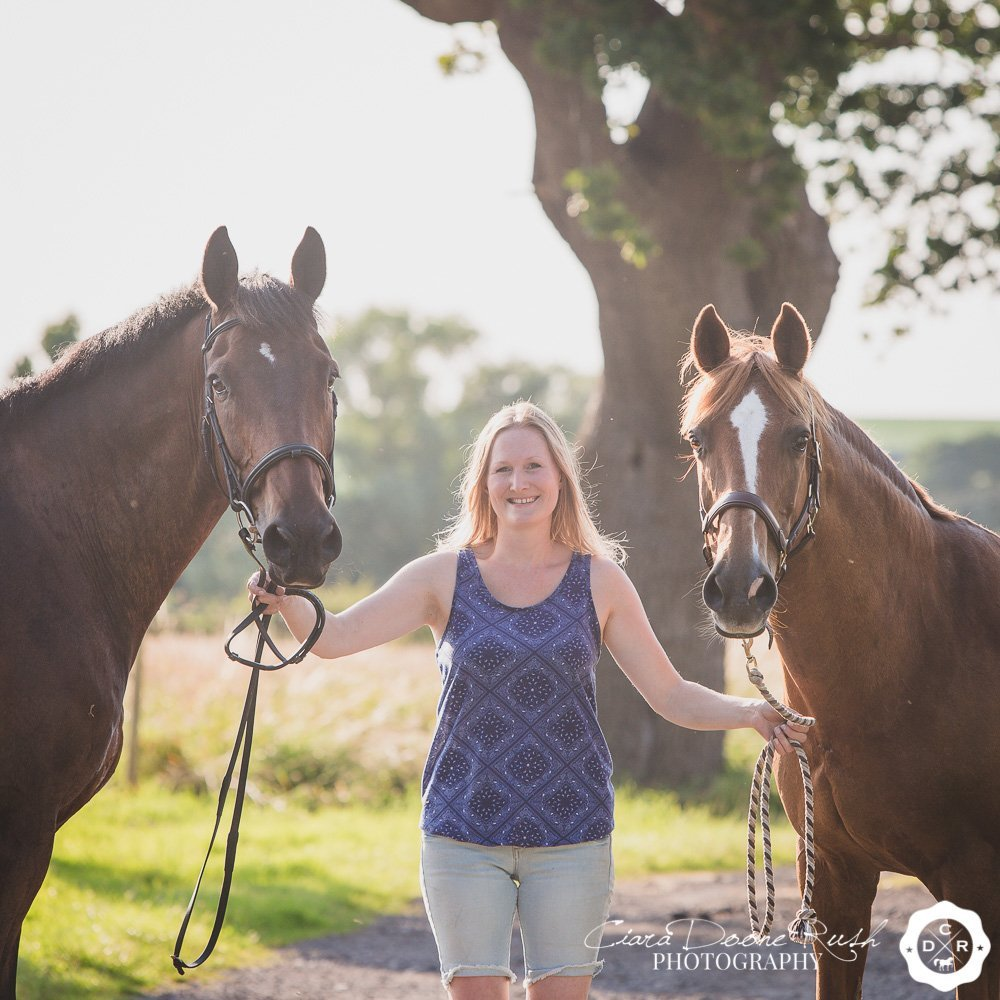 woman with her two horses on a photo shoot