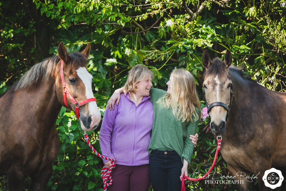 a sisters photo shoot with their ponies