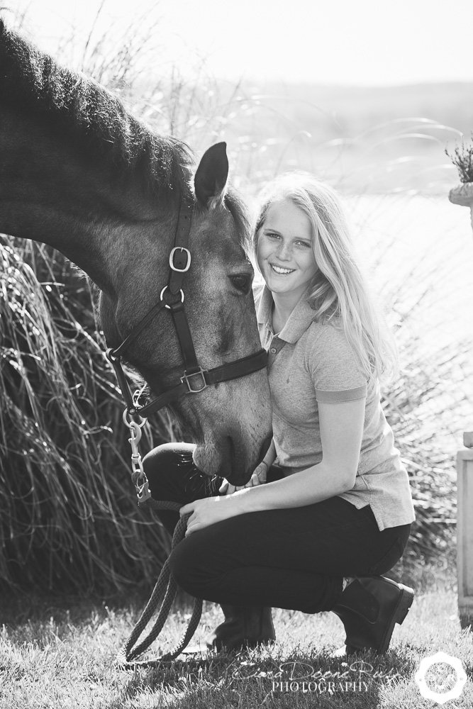 black and white photo of a girl and her pony