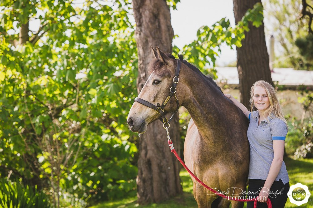 a teenager and her pony on a photo shoot
