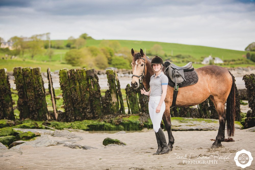 a horse and rider photo shoot on harbour view beach cork