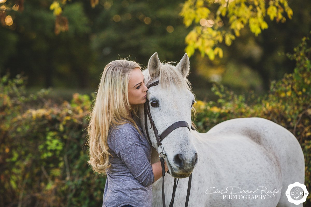 a girl kissing her pony