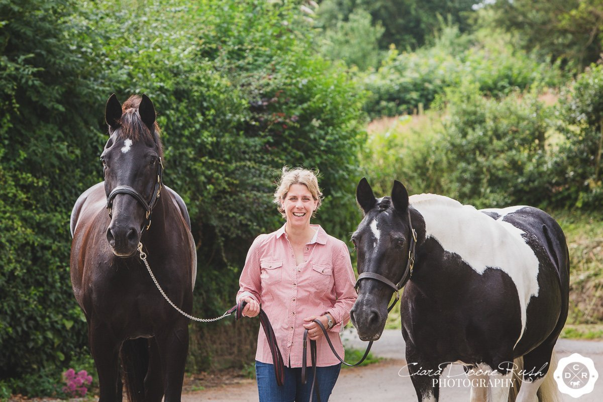 a woman and her two horses on a photo shoot