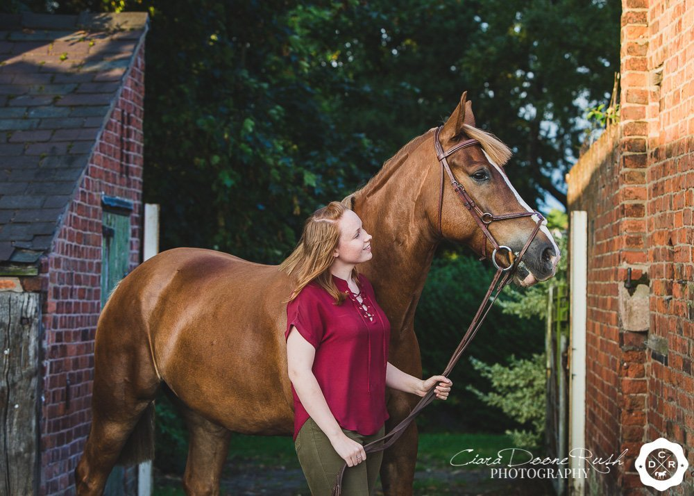 a autumn photo shoot of a girl and her horse