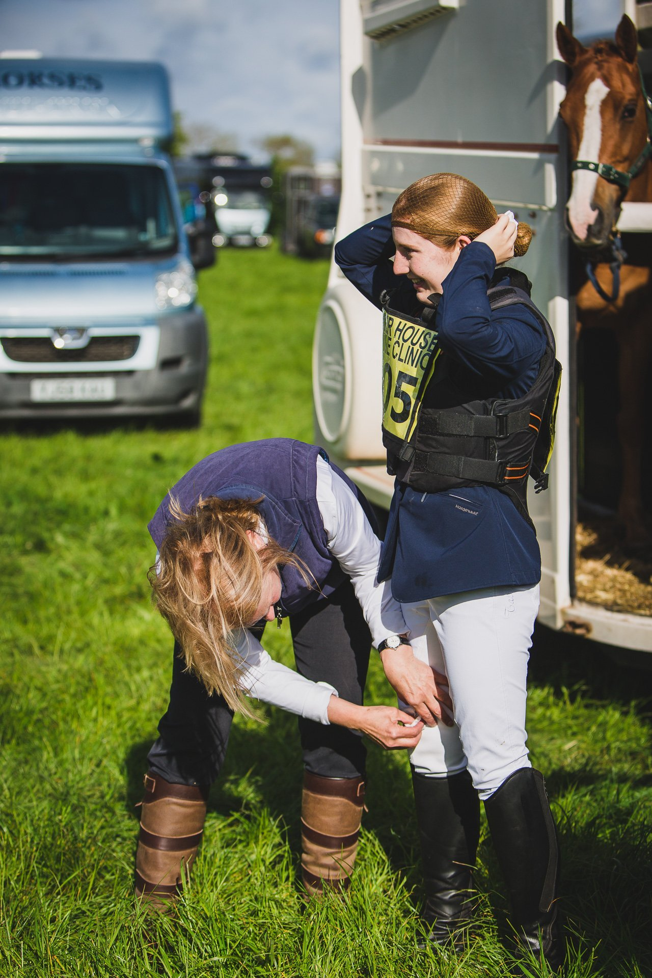 issie's mum helping her get ready for show jumping