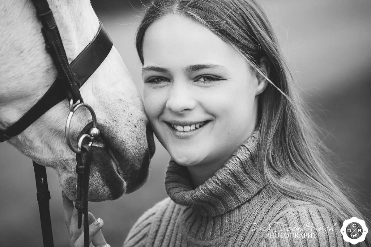 a close up of a rider on a photo shoot