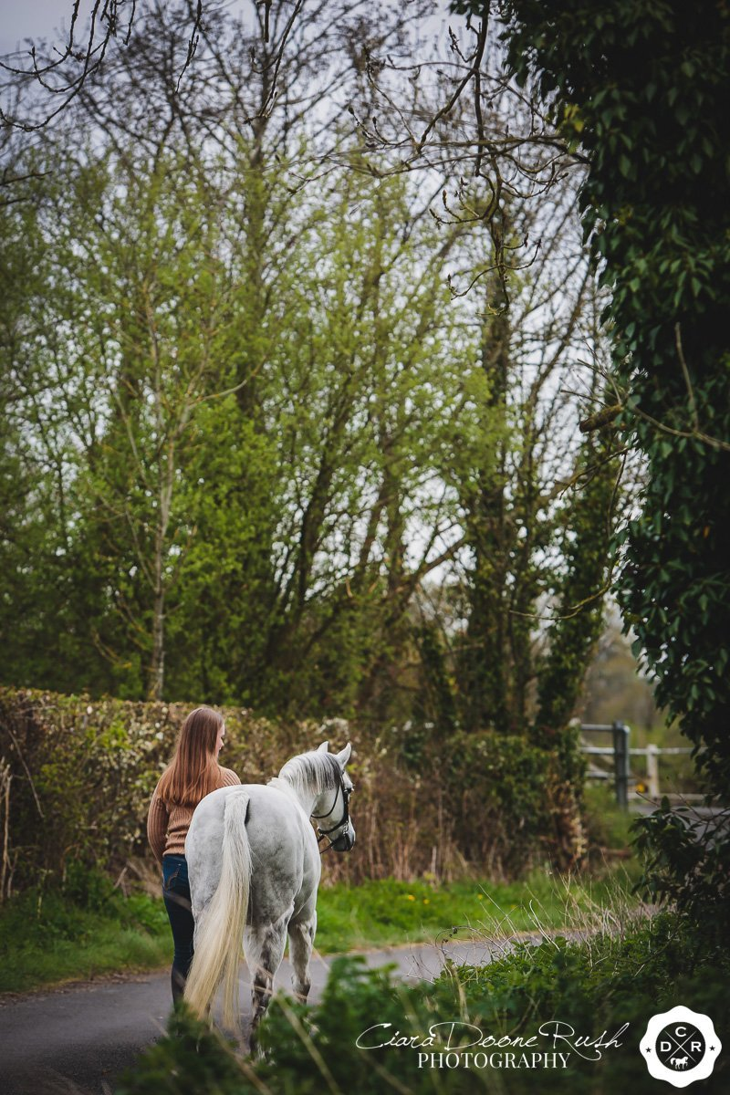 a girl and her pony on a lovely lane