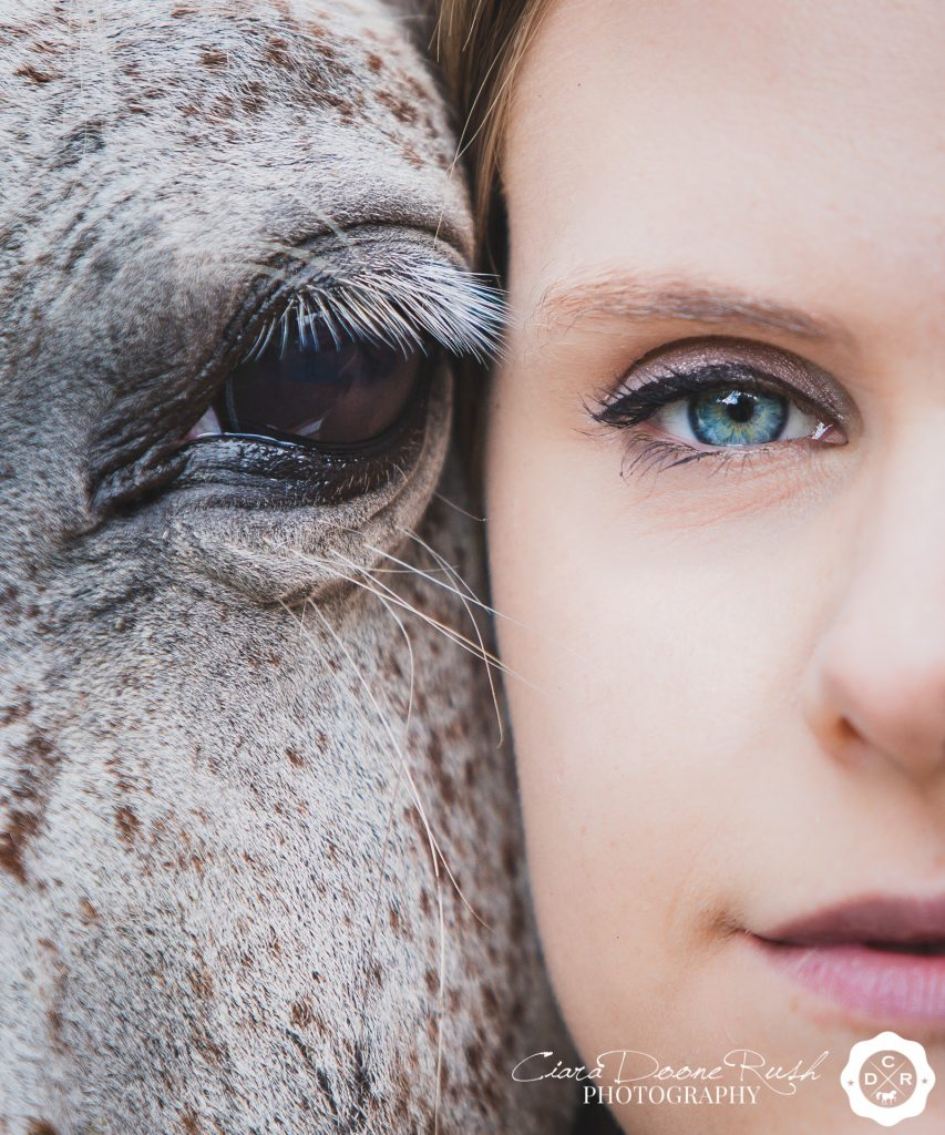 a close up of a horse and riders eyes on a horse and rider photo shoot