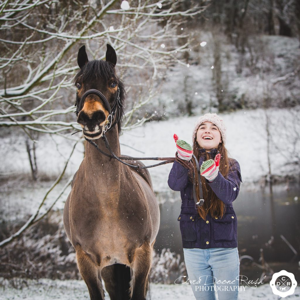 A girl and her pony on a winter horse and rider photo shoot