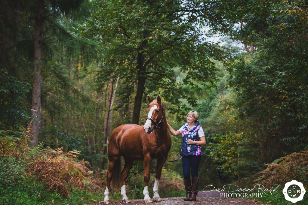 A woman and her horse on a photo shoot in delamere forest