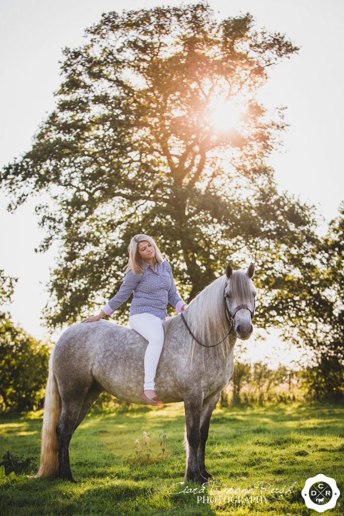 A woman sat on her horse on a horse and rider photo shoot