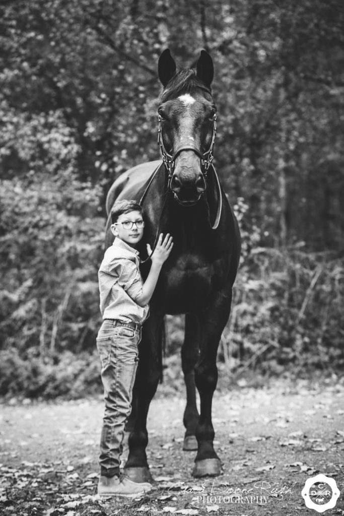a little boy and a big horse on a photo shoot in Delamere