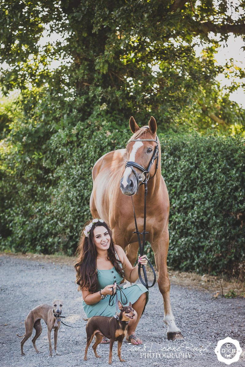 a woman and her horse and dogs