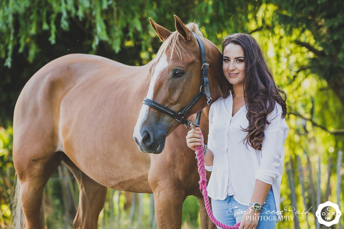 a woman and her horse on a summer evening horse and rider photo shoot