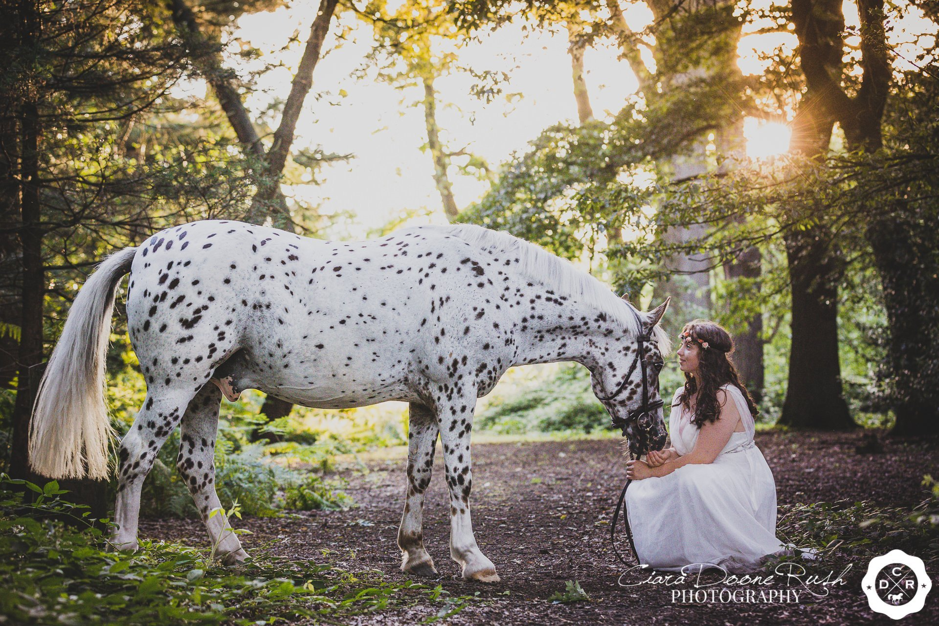 a girl and her horse in the woods
