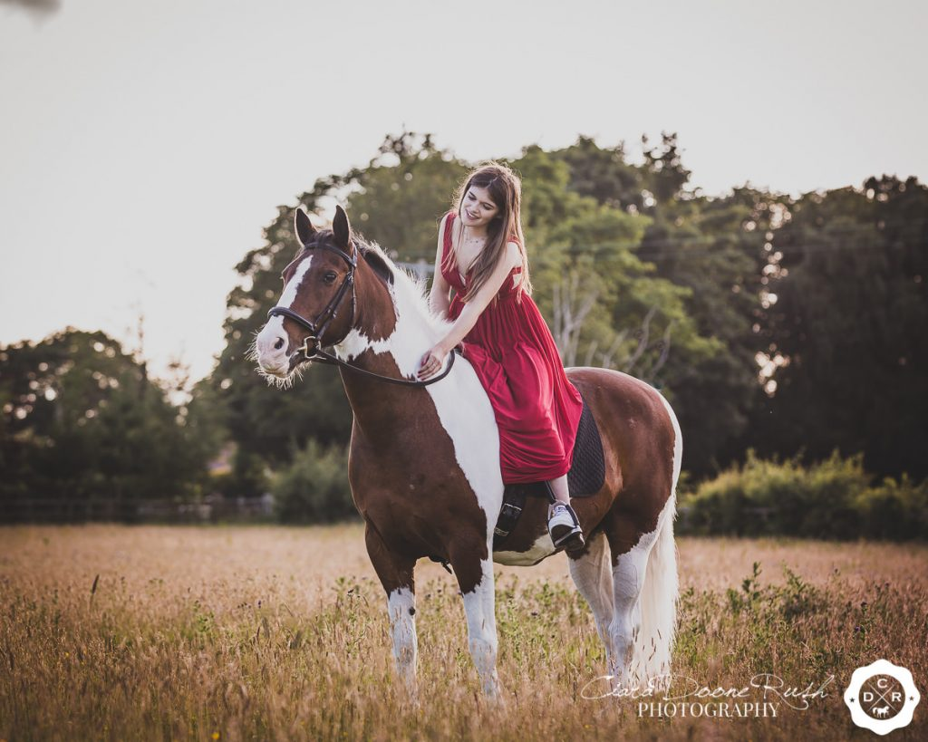 A girl in her Prom Dress on her horse