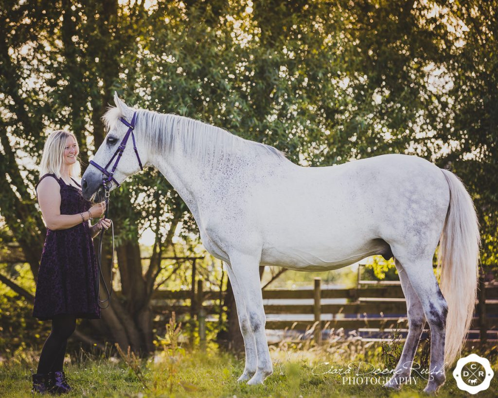 A woman and her Spanish horse on a photo shoot