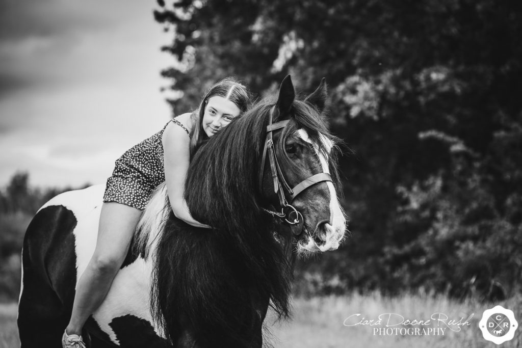A Black and White Horse And Rider Photo