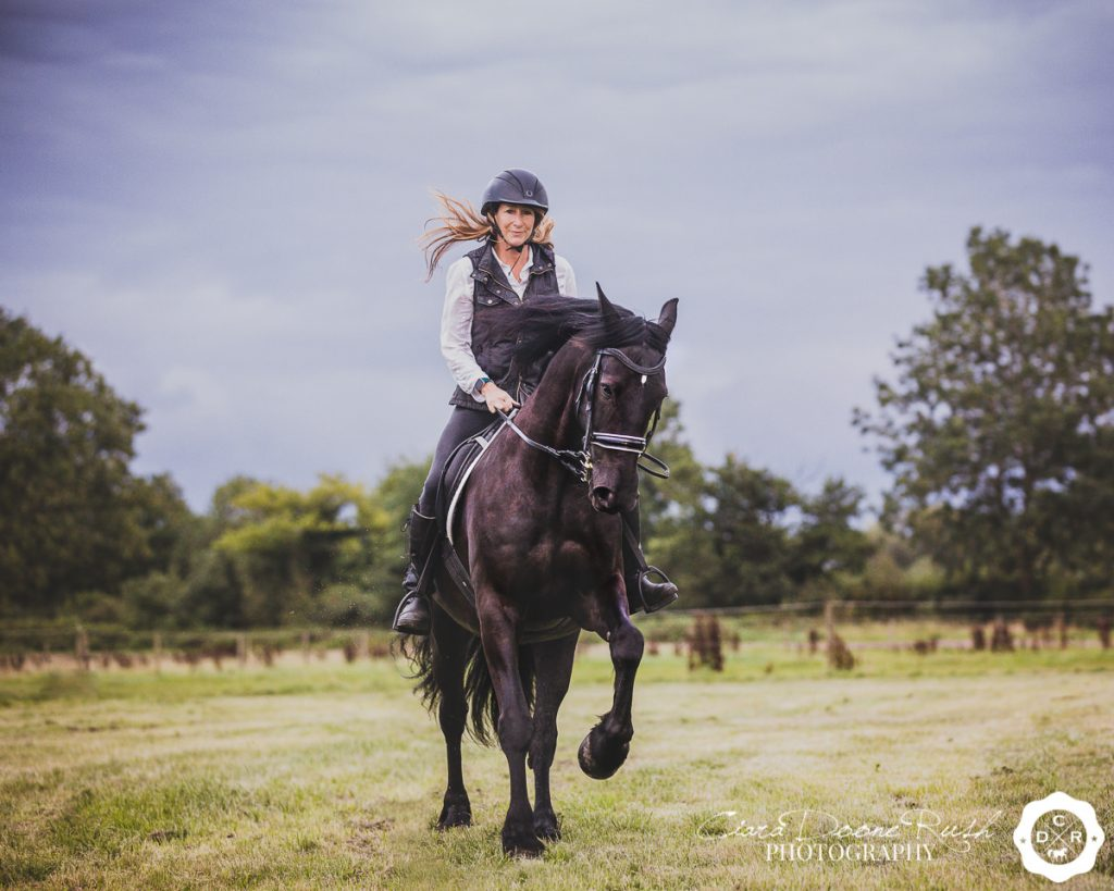 a woman riding her horse on a photo shoot