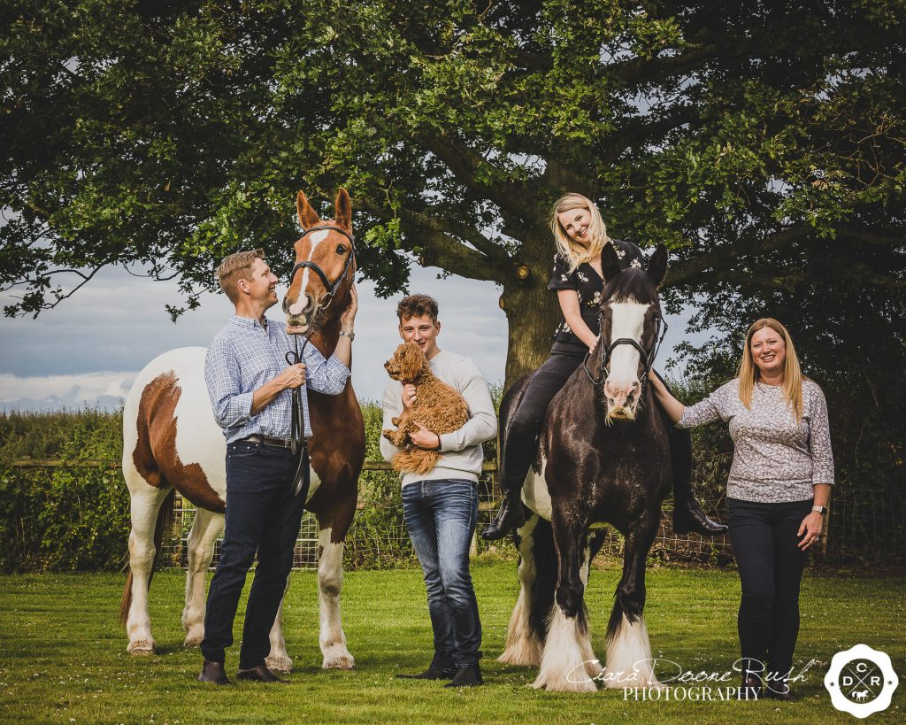 a family, horse and dog photo shoot