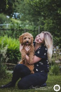 a girl and her dog pn a photo shoot