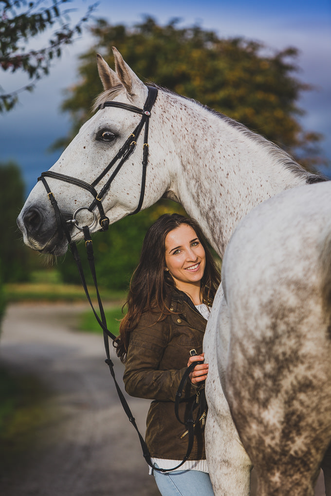 A woman and her horse on a horse and rider photo shoot