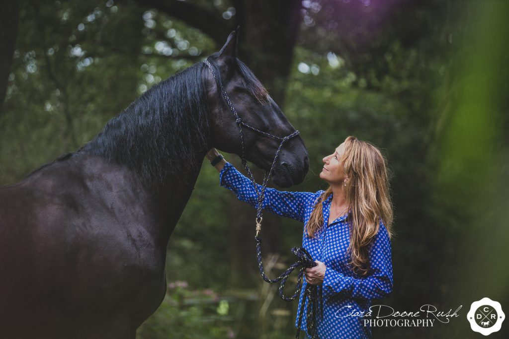 a woman and her Friesian horse