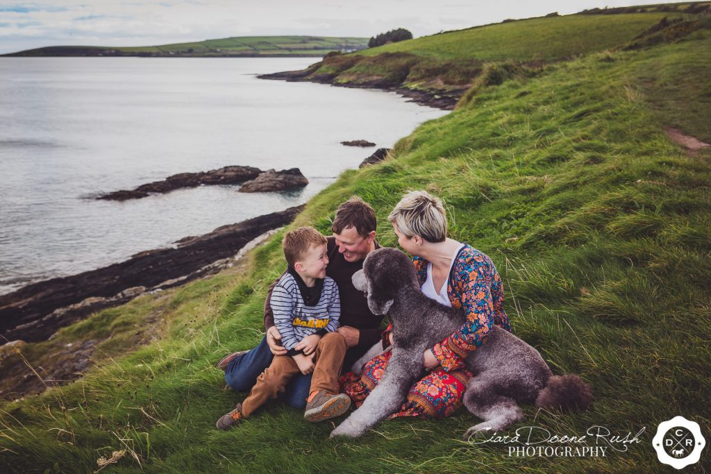 a family and animal photo shoot by the sea
