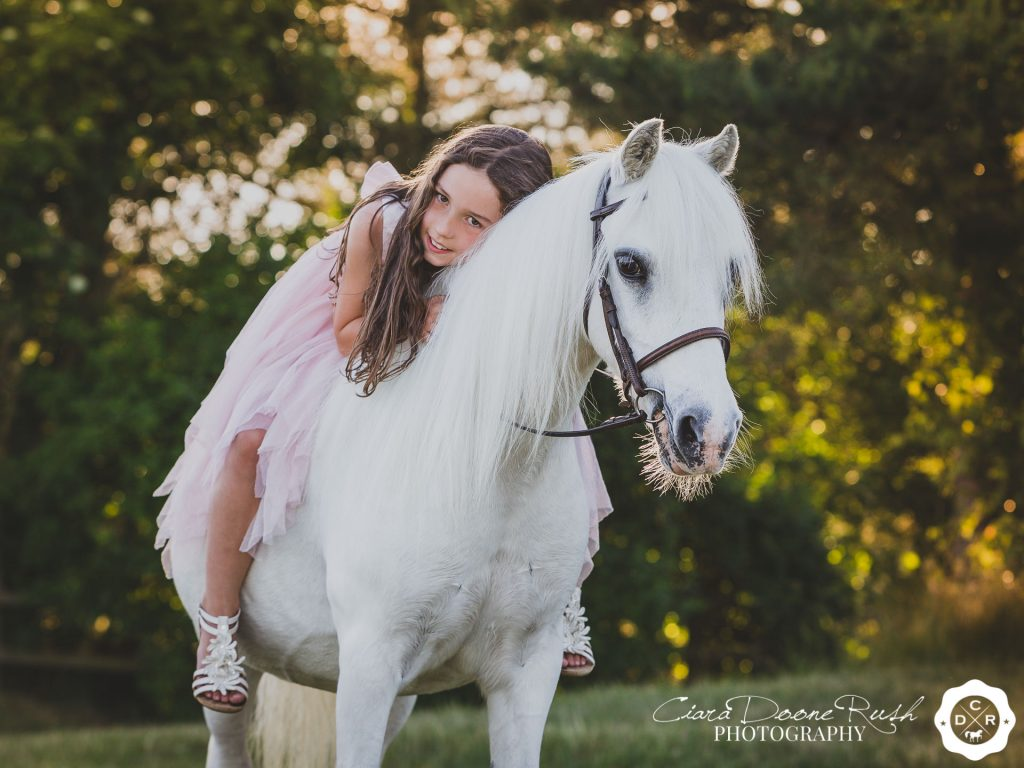 a girl and her pony on a magical photo shoot