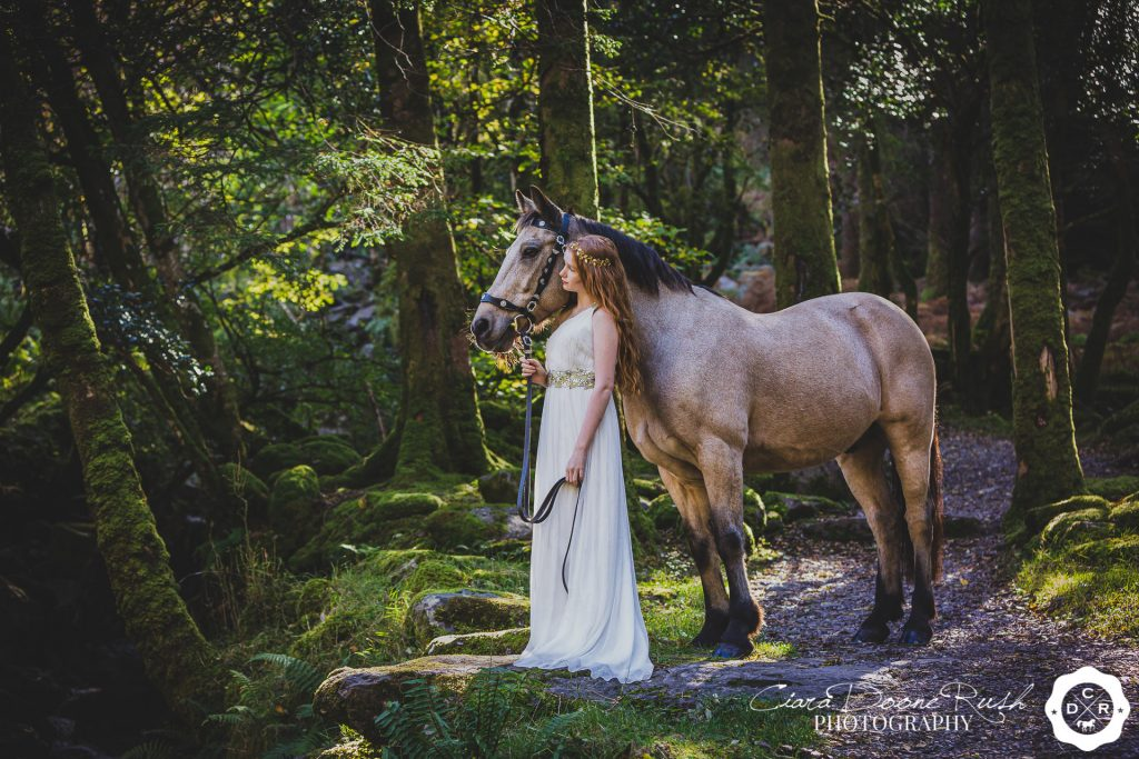 a girl and her pony in the forest fairytale photo shoot
